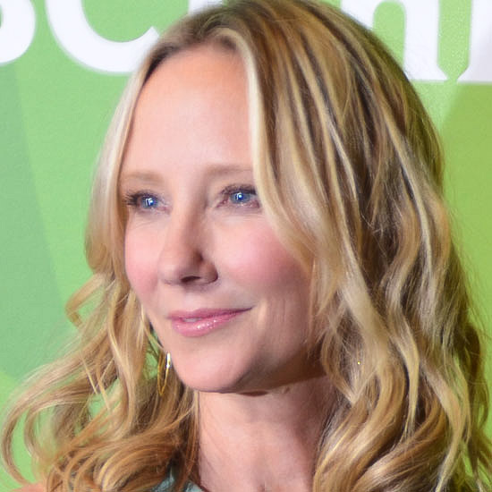 Anne Heche as the Village Idiot