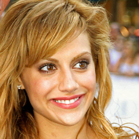 Brittany Murphy as the Village Idiot