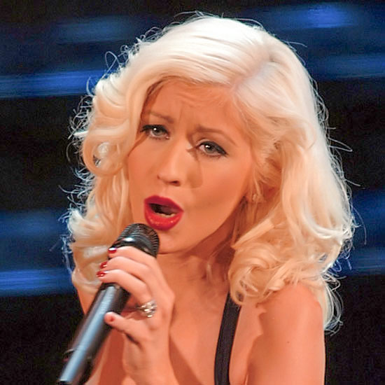 Christina Aguilera as the Village Idiot