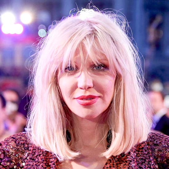 Courtney Love as the Village Idiot