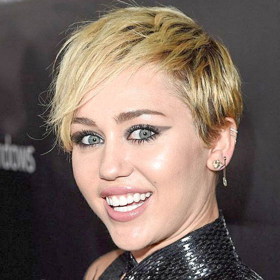 Miley Cyrus as the Village Idiot